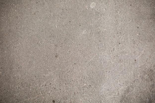 暗い灰色アスファルトの大まかな背景 Premium写真