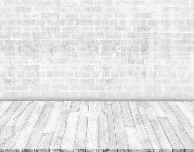 白いレンガの壁と白い木の床 Premium写真