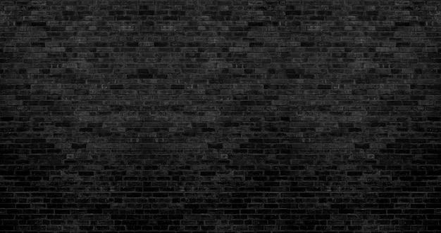 Темно-черная текстура кирпичной стены, кирпичная поверхность для фона Premium Фотографии