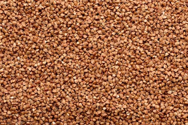 ソバのテクスチャです。生そば粒のテクスチャ。健康食品。上面図。 Premium写真