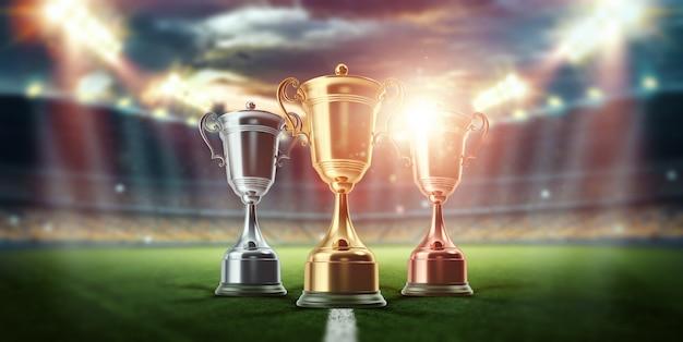 Золотой кубок на фоне стадиона. концепция спорта, победы, награды. копировать пространство. Premium Фотографии