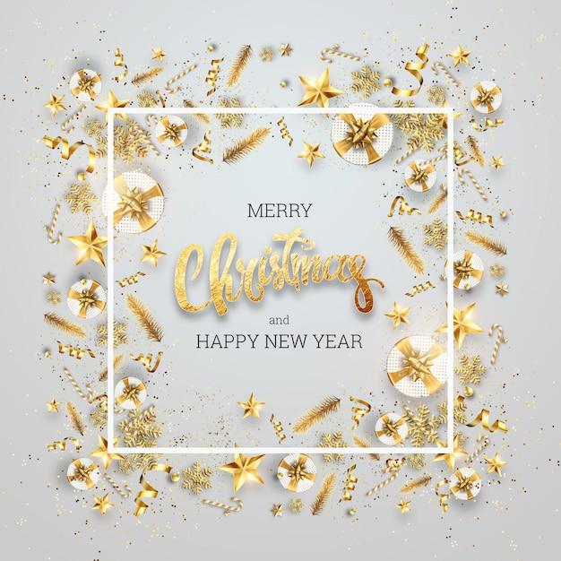 Надпись с рождеством в золотой раме елочных игрушек. открытка, флаер, пригласительный билет. Premium Фотографии