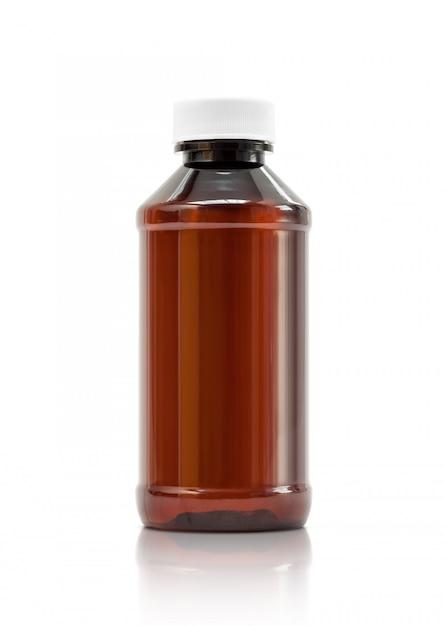 Коричневая пластиковая бутылка с белой крышкой Premium Фотографии