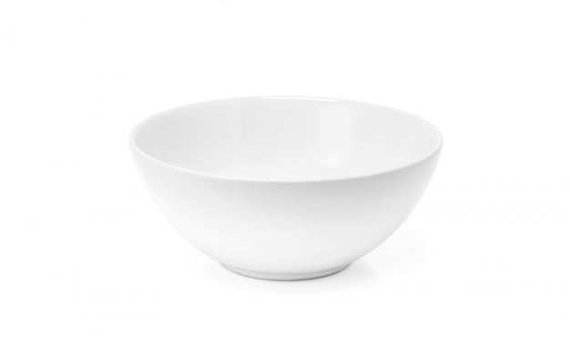 白いセラミックボウルまたは白で隔離される深い皿 Premium写真