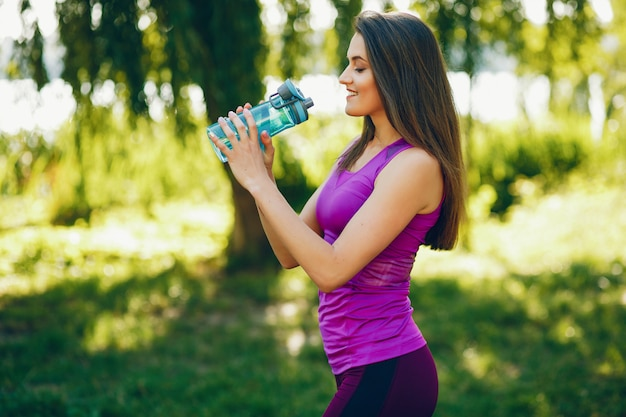 A Beautiful Girl Is Engaged In Morning Exercise In The Park Photo
