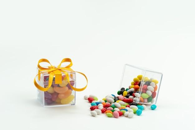 マーマレードと白、色の砂糖の甘い色の正面カラフルなキャンディー 無料写真