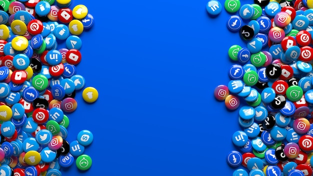 Много 3d многоцветных глянцевых таблеток социальных сетей на синем фоне Premium Фотографии