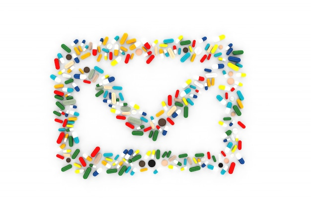 Много таблеток разбросаны на белом фоне в форме конверта сообщения Premium Фотографии