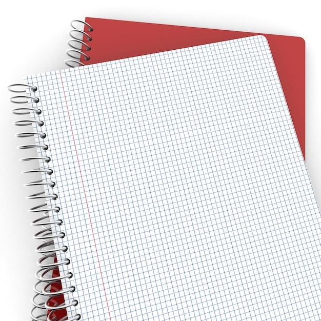 Пара записных книжек, одна закрытая, другая открытая с клетчатыми страницами Premium Фотографии