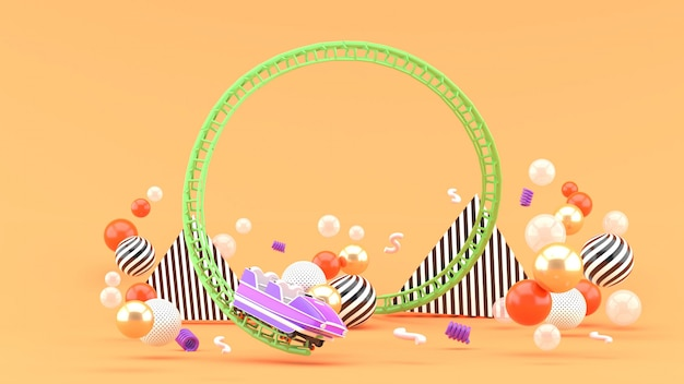 Фиолетовые русские горки среди красочных шариков на апельсине. 3d-рендеринг. Premium Фотографии