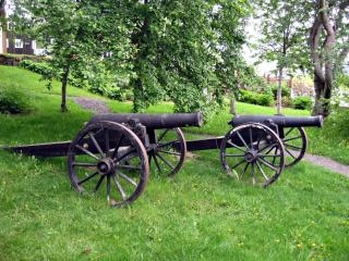 A small cast-iron cannon on a carriage Free Photo