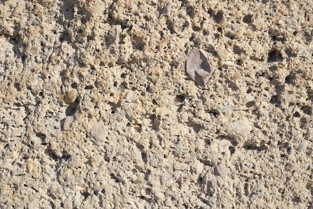 石の壁のテクスチャをクローズアップ Premium写真