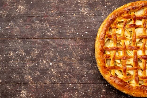 Вид сверху вкусный яблочный пирог круглой формы на темном фоне торт бисквитный сахар фруктовый чай Бесплатные Фотографии