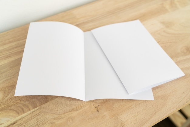 A4 fold brochures on wooden table Premium Photo