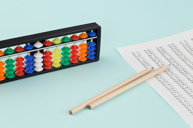 Abacus for mental arithmetic on a light blue background. Premium Photo