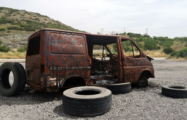 Abandoned burnt out car Free Photo