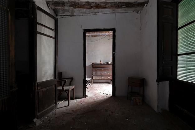 Abandoned house room among shadows Premium Photo