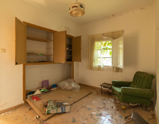 Abandoned living room with furniture and arm chair Premium Photo