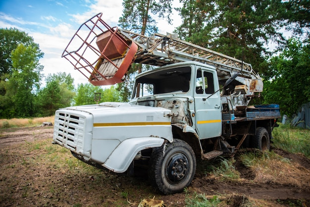 Abandoned old truck in a clearing, grunge equipment, disassembled broken Premium Photo