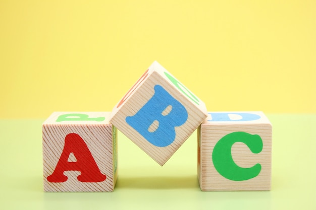 Abc -the first letters of the english alphabet on wooden toy cubes. Premium Photo