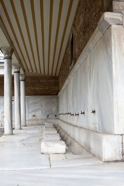 Ablution taps at a mosque in istanbul where worshippers wash their feet. aya sofia istanbul Premium Photo