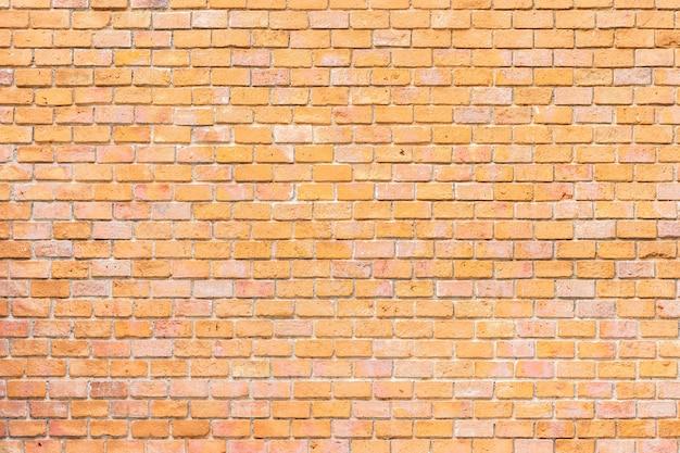 抽象的なと表面の古い茶色のレンガ壁の背景 無料写真