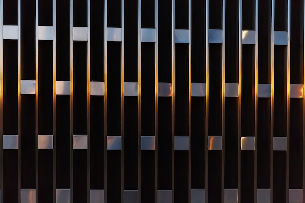 Abstract architectural detail of vertical lines with squares of metal at sunset. Premium Photo