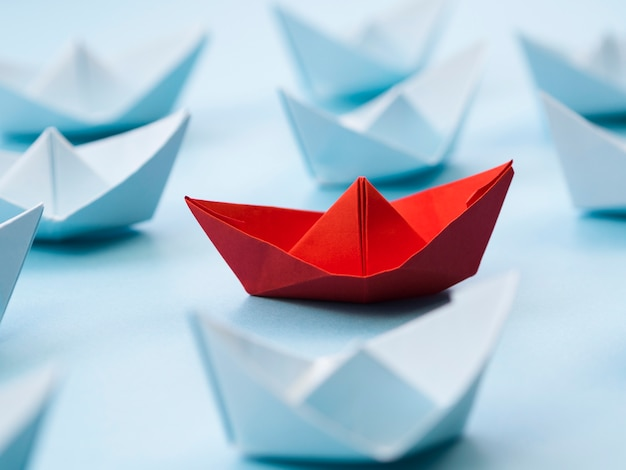 Abstract arrangement with paper boats Free Photo