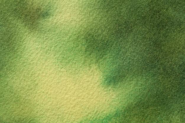 抽象芸術の背景の濃い緑と黄色の色。ソフトオリーブのグラデーションでキャンバスに水彩画。 Premium写真