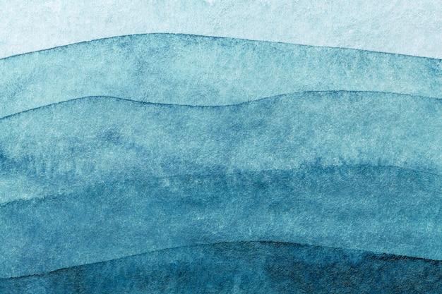 Абстрактное искусство фон темно-синий цвета. акварельная живопись на холсте с бирюзовым узором из морских волн. Premium Фотографии