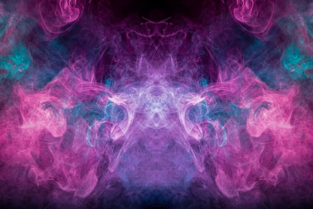 Abstract art colored smoke on black isolated background. Premium Photo
