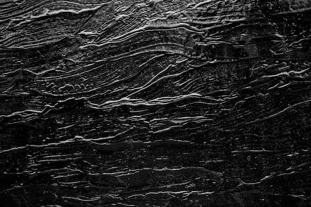 Abstract background from black rock texture plate decorated on wall Premium Photo