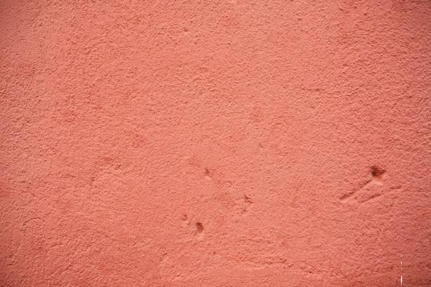 그런 지와 긁힌 빈티지 배경으로 오래 된 빨간 콘크리트 질감에서 추상적 인 배경 프리미엄 사진