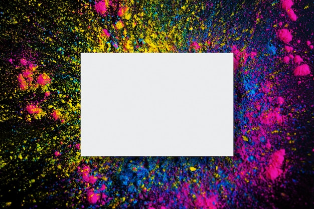 Abstract background of holi color explosion with empty frame Free Photo
