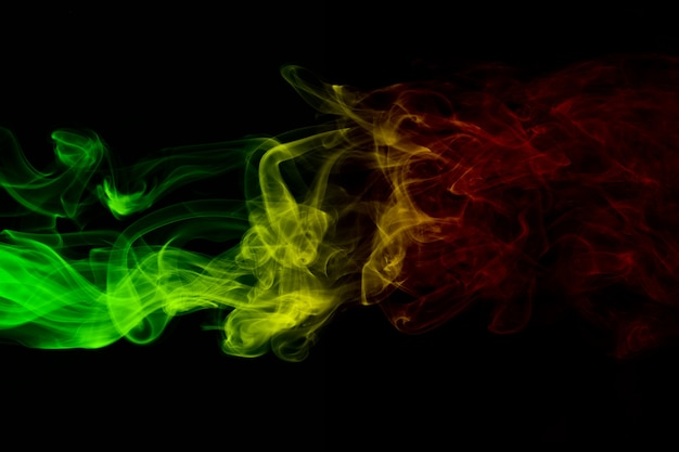 Abstract background smoke curves and wave reggae colors Premium Photo