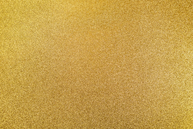 Abstract background of textures of golden shine.concept of christmas Premium Photo