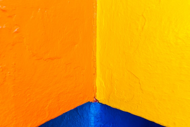 Abstract background of variable geometry and intense yellow and blue colors. Premium Photo