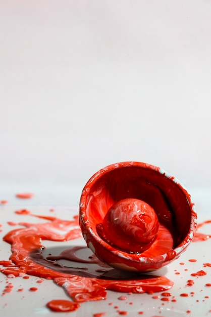 Abstract background with red paint splash and cup Free Photo
