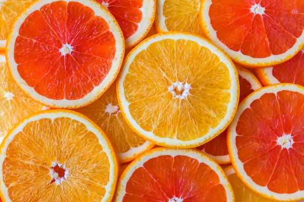 Abstract background with slices of yellow and red oranges Premium Photo