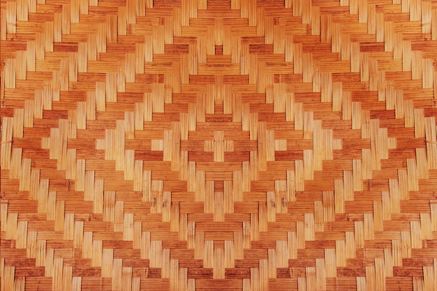 Abstract bamboo woven pattern texture for background. detail of wall of country house made of bamboo Premium Photo