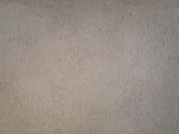 Struttura beige astratta della parete del cemento del grunge. Foto Gratuite