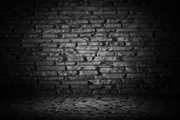 ボーダー黒ビネットbackgrounを持つ抽象黒セメントレンガ 無料写真