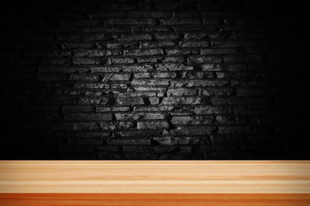 Abstract black grunge brick and wooden table deck. Free Photo
