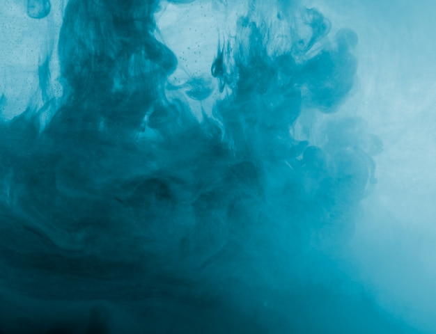 Abstract blue cloud of haze in liquid Free Photo