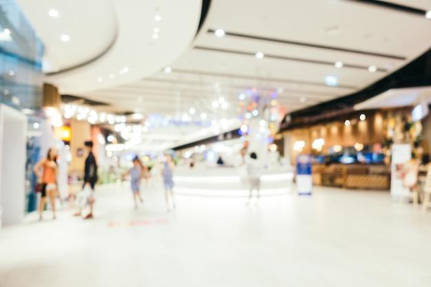 Абстрактное размытие и боке расфокусировали интерьер торгового центра универмага Бесплатные Фотографии