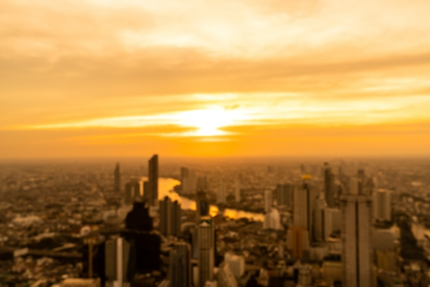 Abstract blur bangkok cityscape in thailand with sunset sky Premium Photo