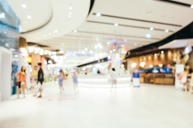 Abstract blur and bokeh defocused shopping mall interior of department store Free Photo
