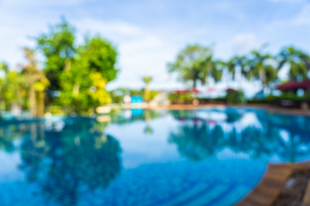 Abstract blur and defocus beautiful outdoor swimming pool in hotel resort, blurred photo background Free Photo