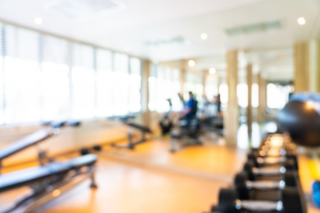 Abstract blur and defocus fitness equipment in gym interior Free Photo