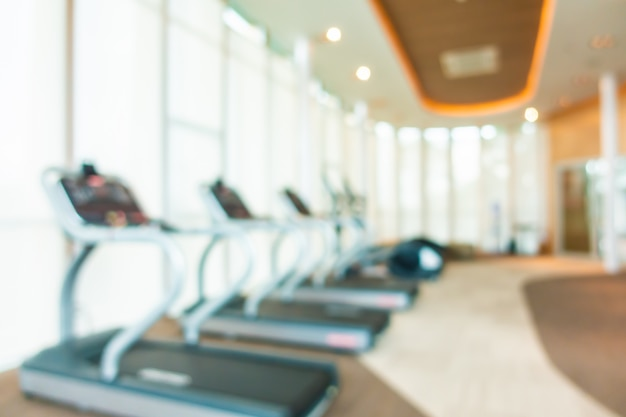 Abstract blur and defocus fitness equipment in gym room interior Free Photo